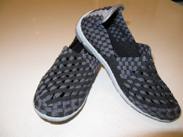 Black and grey open weave enclosed